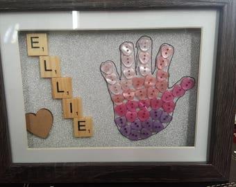 Baby button handprint frame