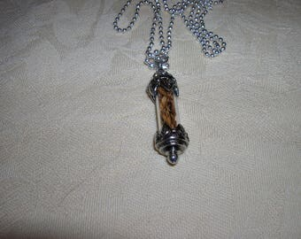 A pendant filled with cedar seeds