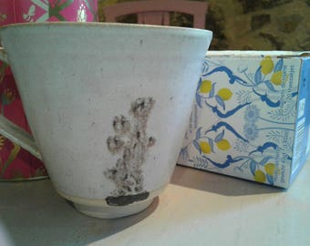 Stoneware ceramic mug, made by hand. Ceramic