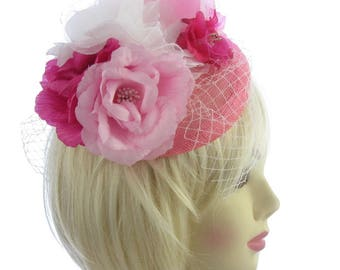 Pink flower hatinator strong clip and netting, weddings, races, ladies day