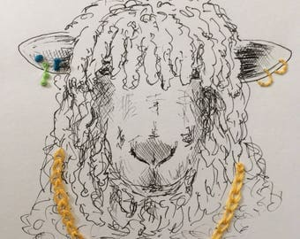 Framed, pen and ink sheep with embroidered necklace and earrings