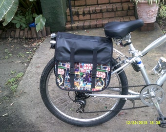 Waterproof pannier, cotton print with nylon lining.  Vinyl overflap and back.