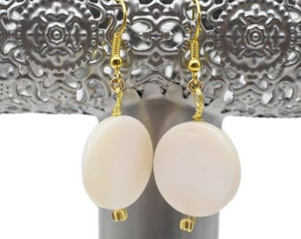 Coin shell dangle earrings with gold accents