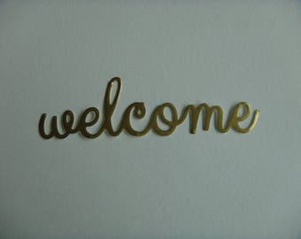 """Cut out """"Welcome"""" vinyl gold to create"""