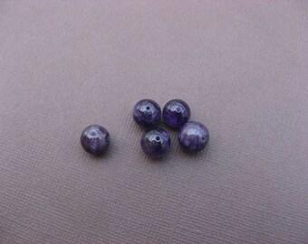 Amethyst: 3 round beads 8 mm