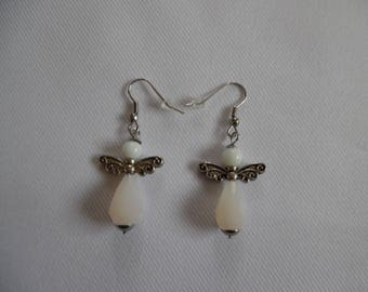Earrings white angels, mounted on stainless steel glass beads.