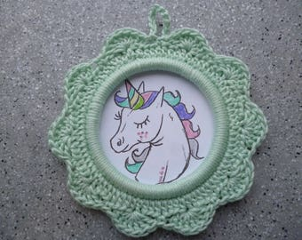 Round frame Unicorn crocheted in light green color cotton