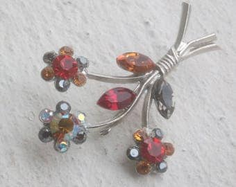 Brooch: Three flowers in red - honey and black diamond Swarovski crystals