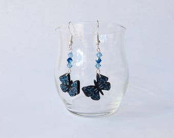 Blue butterfly earrings and blue beads