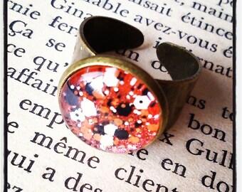 ring cabochon has orange and white/black glitter on metal bronze