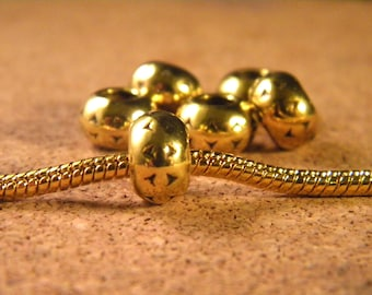 10 European bead Tibetan metal - gold - 10 to 15 mm