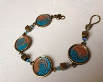 beautiful handpainted turqoise caramel, bronze medallion
