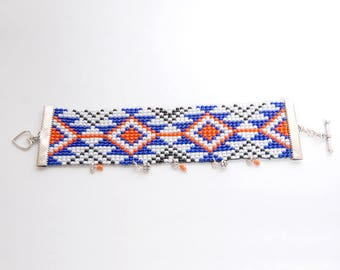 Shaman - Orange and blue charms and beads woven navajo cuff