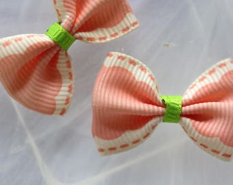 Pretty pale pink ribbon bow is stipple