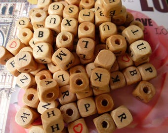 10 cubes are 10 mm wood letters of the alphabet marked in black in a set