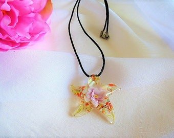 lampwork glass heart pink flower on a glitter background with orange, green and yellow Murano style star pendant necklace