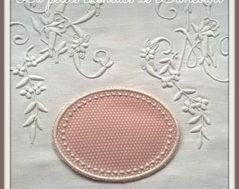 Medallion beaded with ivory dots on pink background