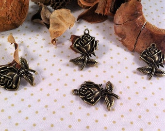 10 pendants in the shape of rose and leaves in relief bronze
