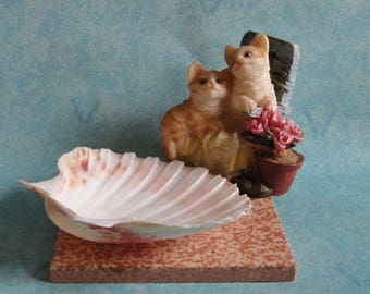 ashtray, empty pocket, candle, table decoration, table centerpiece, shell st. jacques and kittens