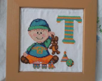 """Wood frame with embroidered """"T"""" baby alphabet"""