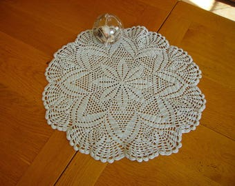 grey round doily with central rose