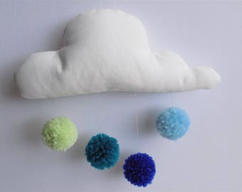 white cloud mobile and its four tassels of blue-green