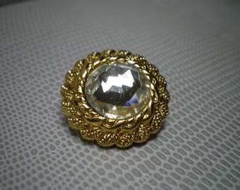 circle gold with an rhinestone button Center