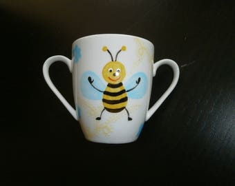 Cup with handle handpainted bees and interlacing pattern name