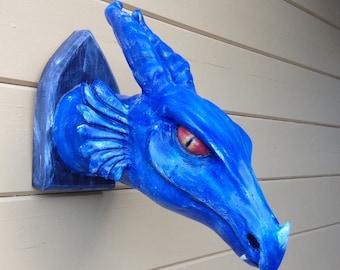 Blue polyester resin dragon sculpture.