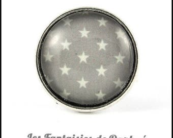 ring silver plated star on gray background