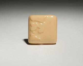 Bright yellow ceramic square ring