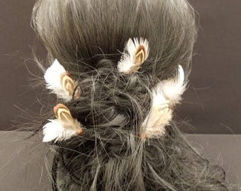 A Brown and white feather hair pins