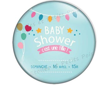 """Magnet Baby Shower feathers blue """"It's a girl"""" background"""