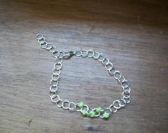 Bracelet green beads and rings