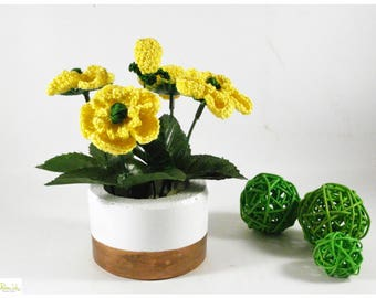 Concrete decorative vase with yellow crocheted buttercups