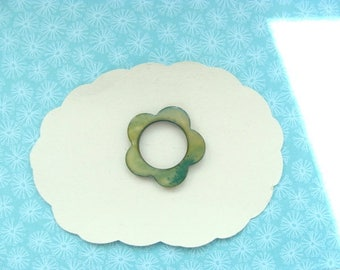 1 hollow green mother of Pearl flower pierced