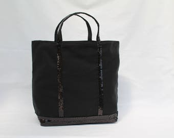 The black bag with round glitter black