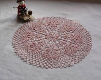 Handmade pink cotton crochet lace doily.
