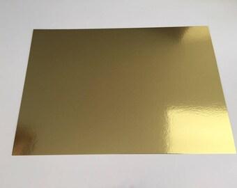 A4 Papier carton holographique effet miroir  - uni sans motifs -  couleur vive  - or / doré / jaune