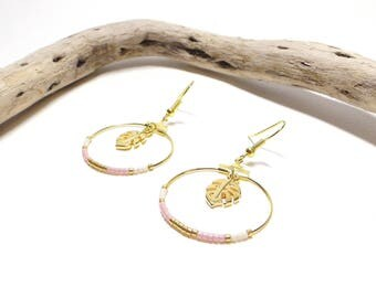 Gold hoops and monstera leaves