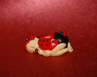 Sleeping baby decorated Mod #4 fimo/Polymer Clay figurine