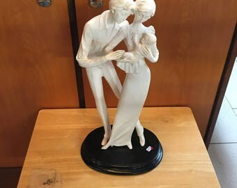Statue a. Santini couple with baby