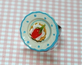 Strawberry Cupcake and whipped cream ring on plate