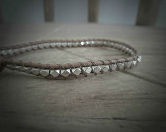 Light brown leather bracelet with silver beads