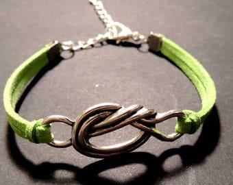 Bracelet suede color green, metal bow