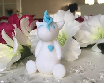White glitter unicorn with aqua details