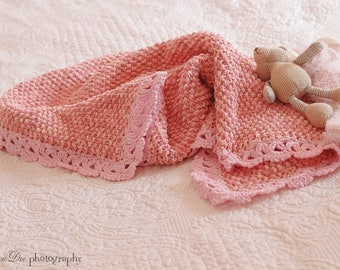 Pink baby blanket with lace