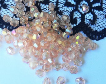 SWAROVSKI Crystal beads ROSES 10 clear 4 mm (34T)