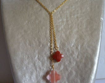 Double Red clover suspended on gold chain necklace