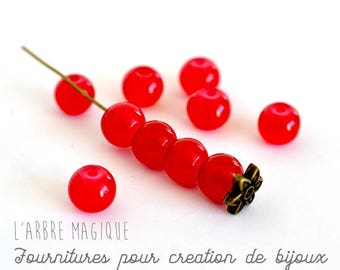 Red glass 8 MM round bead set sold in packs of 10 units